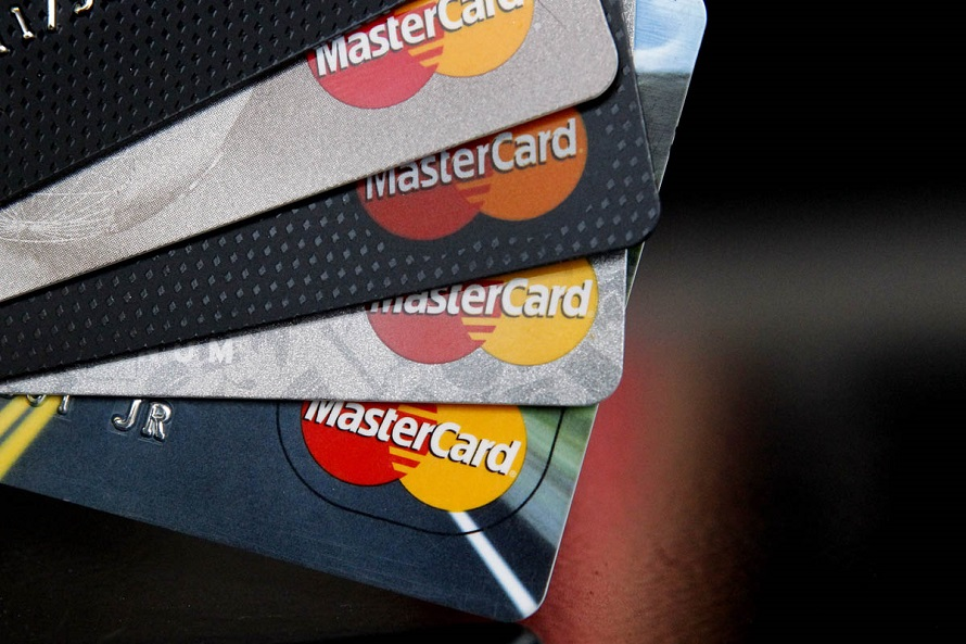 FILE - In this Thursday, April 25, 2013, file photo, MasterCard credit cards are displayed for a photographer in Montpelier, Vt. MasterCard Inc. reports quarterly financial results before the market opens on Thursday, Oct. 31, 2013. (AP Photo/Toby Talbot, File)